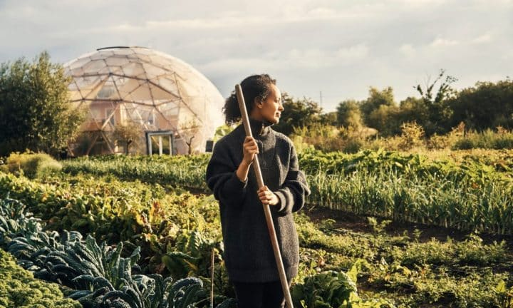 Woman standing in a field of diverse crops